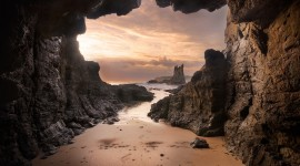 Beach With Caves Desktop Wallpaper