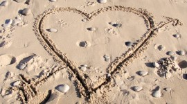Love In The Sand Photo Free
