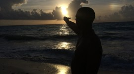 The Sun In The Hands Photo
