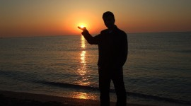 The Sun In The Hands Photo Download