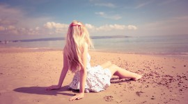 Girl In The Sand Wallpaper