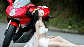 4K Girl On A Motorcycle Photo#1