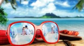 Glasses On Sand Image Download