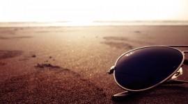 Glasses On Sand Wallpaper 1080p