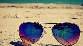 Glasses On Sand Wallpaper