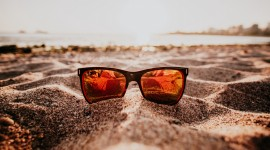 Glasses On Sand Wallpaper Download