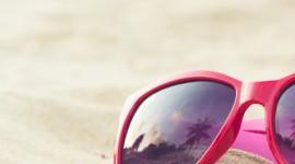 Glasses On Sand Wallpaper For Mobile