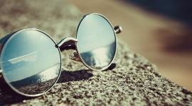 Glasses On Sand Wallpaper Free