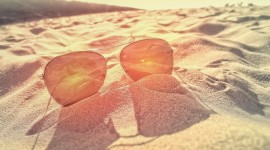 Glasses On Sand Wallpaper Full HD