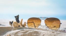 Glasses On Sand Wallpaper HQ