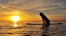 Surfer Sunset Photo