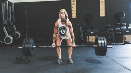 The Girl Lifts The Bar Image